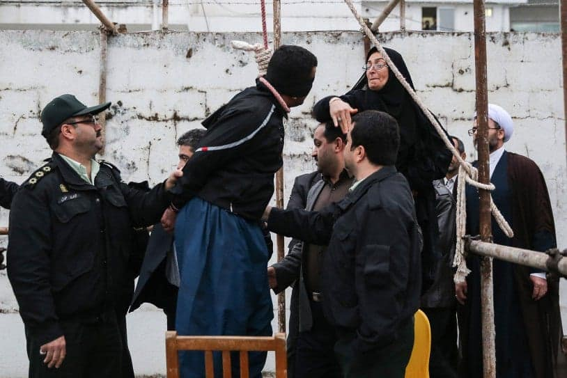 The mother (R) of Abdolah Hosseinzadeh, who was murdered in 2007, slaps Balal who killed her son during the execution ceremony in the northern city of Nowshahr on April 15, 2014 just before she removed the noose around his neck with the help of her husband, sparing the life of her son's convicted murderer. The dramatic events followed a rare public campaign to save the life of Balal, who at 19 killed another young man, Abdollah Hosseinzadeh, in a street fight with a knife back in 2007. AFP PHOTO/ARASH KHAMOOSHI/ISNAARASH KHAMOOSHI/AFP/Getty Images